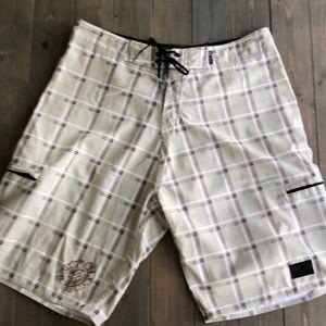 Men's cream colored board shorts
